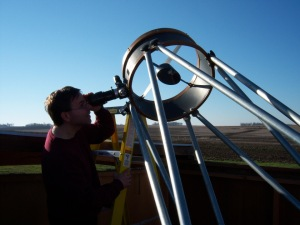 Cory Martin observing through the 17.5″ reflector at Fugman Observatory. Photo courtesy of Northeast Nebraska Astronomy Club.