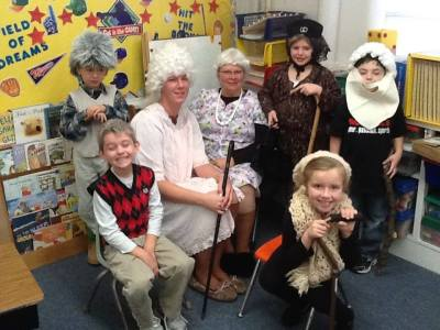 100 days of school was celebrated in Marlene Beacom's class at LDNE. Pictured are, from left: Kaden Knaak, Weston Hardeman, Chelsey Dunning (Mrs. Beacom's paraprofessional), Mrs. Beacom, Avery Bacon, Eli Schlichting and Aubrey Lauritsen is in front. Photo courtesy of LDNE.