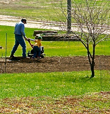 Gordy Olson and his grandson Tristen are tilling the garden for planting. Photo Credit/Denise Gilliland, Editor and Chief, Kat Country Hub.