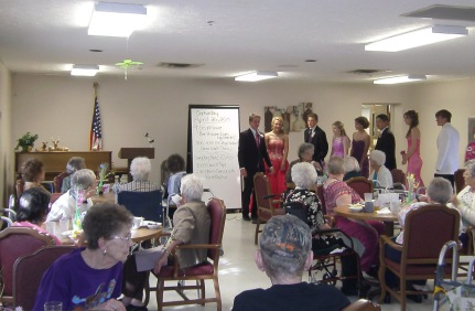 OC students model their prom attire for the residents at Oakland Heights. Photo courtesy of Oakland Heights.