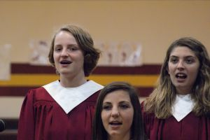The High School Choir performed.  Pictured L-R-Lena Horak, Blair Preston, and Amelia Schlichting. Photo Courtesy of LDNE.