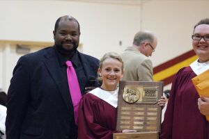 Sarah Alford Received the National Choral Award which is the highest choral award given.  L-R-John Mayo, Sarah Alford, Jessie Mutum. Photo Courtesy of LDNE.