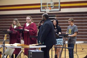 """4404-The Northeast iPad Ensemble was featured during the concert.  Here you see the iPad Ensemble performing """"Ice, Ice, Baby"""" by Vanilla Ice. L-R- Amelia Schlichting, Jessie Mutum, Shyanne French (covered up by Mr. Mayo), Sophie Hsu, and Jacob Swanson. Photo Courtesy of LDNE."""
