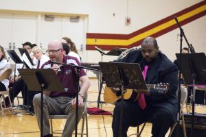 """The Northeast Guitar Ensemble accompanied Northeast staff member Steve Hosch in """"Here Comes The Sun"""" by The Beatles. Photo Courtesy of LDNE."""