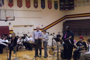 """The Northeast Guitar Ensemble accompanied the No Name Singers for their rendition of """"Hotel California."""" The No Name Singers are Northeast Staff Members from L-R Katie Mace (lead vocals), Paul Timm, (backup vocals), Pat Sharp (Back up vocals), John Mayo and students L-R Bailey Beaumont and Aaron Williams played guitar. Photo Courtesy of LDNE."""