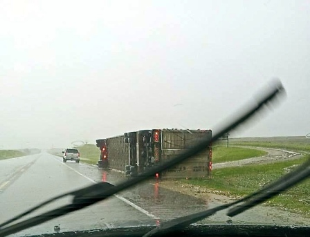 This semi was a victim of strong winds from the storm going through eastern Nebraska, just north of Uehling,  today. Photo Credit/Kristi Dahlgren.