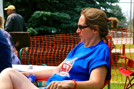 Julie Svendsen was among many watching the horseshoe tournament in Lyons on the 4th of July. Photo Credit/Denise Gilliland, Editor and Chief, Kat Country Hub.