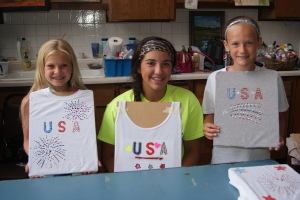 Patriotic and proud are these three 4-H members as they show off the patriotic t-shirts they created at the 4-H workshop last week. Pictured are: Lacey Petersen, Ashley Bohannon and Emma Wakehouse. Photo Courtesy of Mary Loftis.