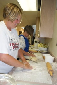 Molly Willing and Susan Skinner roll pie dough at the 4-H pie day. Photo Credit/Mary Loftis.