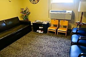 The waiting room has been moved down the hall and also has a coffee bar. Photo Credit for both/Denise Gilliland, Editor and Chief, Kat Country Hub.