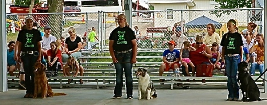 Sit and stay! All did well at the fair. Megan, Casey and Hayley are pictured here with the cute dogs! Photo Credit/Denise Gilliland, Editor and Chief, Kat Country Hub.