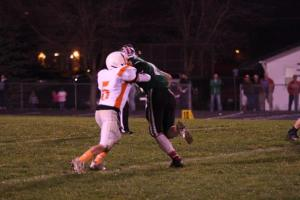 Cody Mallette takes on a Wisner-Pilger player on one of his six tackles for the night. Photo Credit/Cheri Droescher.