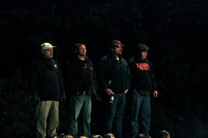 This group of guys watches the game very intently! From left, Rusty Droescher, former head football coach and O-C Principal, David Uhing, Mark Smith and Jay Johnson, all of whom have boys playing on the team. Photo Credit/Cheri Droescher.