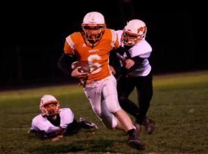 Evan Reinert takes down Stanton players on this run. Photo Credit/Cheri Droescher.