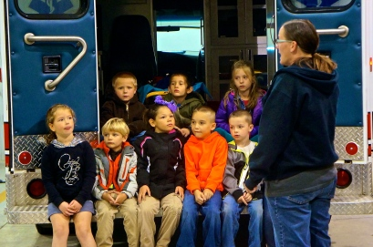 Lyons Fire and Rescue member Angela Whitley quizzes this group of kindergartners on what to do in case of a fire in the house. Photo Credit/Denise Gilliland, Editor and Chief, Kat Country Hub.