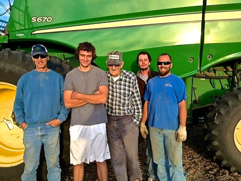 Justin Beck, right, works for the Nelson family of Wayne. They are all busy harvesting now, as are all farmers. From left is Don Nelson, Geoff Nelson, Marvin Nelson, whom is 91 years old and is still combining, and Taylor Nelson is behind Justin. Photo courtesy of Justin Beck.