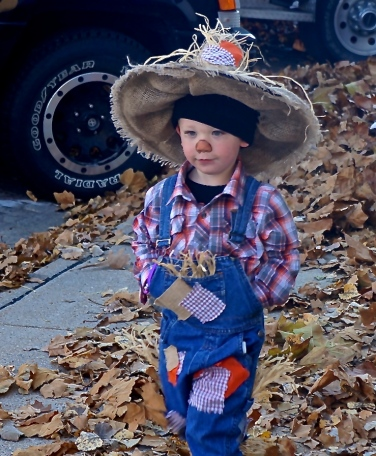 Trey Sluyter, son of Brooke Johnson and Tommy Sluyter has quite the scarecrow costume! He was one of many, many children trick or treating on Oakland's Main Street! Photo Credit/Denise Gilliland, Editor and Chief, Kat Country Hub.