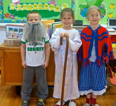 Ryan Tuttle, from left, Linden Anderson and Lexus Petersen are dressed as 100 year olds to celebrate the 100th day of Kindergarten. Photo Credit/Denise Gilliland, Editor and Chief, Kat Country Hub.