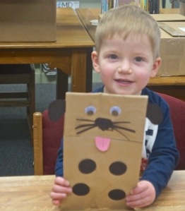 Blaise Hartwell proudly displays the puppy he made during craft time at the Oakland library. Photo Credit/Denise Gilliland, Editor and Chief, Kat Country Hub.