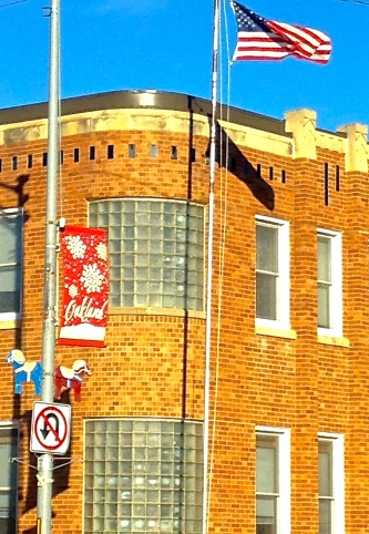 The flag pole in front of the Oakland City Auditorium has been repaired and a new flag is now flying, thanks to the assistance of the Oakland city employees. Photo Credit/Denise Gilliland, Editor and Chief, Kat Country Hub.