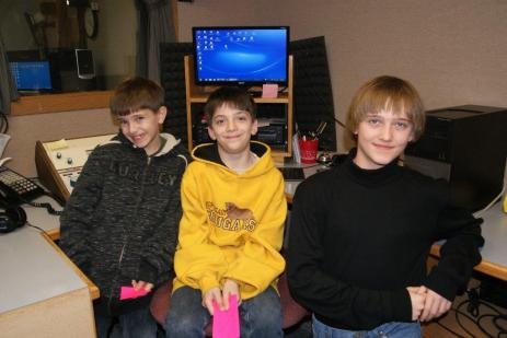 Burt County 4-H Week is February 22-28. These three 4-H members taped  their 4-H Public Service Announcement at KTIC/KWPN radio last week to promote Burt County 4-H. They are: Andrew Schlichting, Lyons; Caleb Schlichting, Lyons and Cody Bachtell of Tekamah. Also taping, but not available for the picture is Faith Roscoe of Lyons. Photo by Mary Loftis.