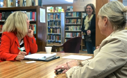 Representative for U.S. Senator Deb Fischer, Tiffany Settles, from left, Rosa Schmidt, library director and Executive Director for Burt County Economic Development Corporation Patty Plugge visit about local and regional issues at the Oakland Library recently. Photo Credit/Denise Gilliland, Editor and Chief, Kat Country Hub.