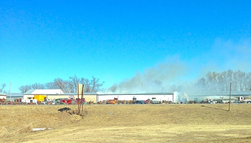 Fire departments from Lyons, Oakland, Bancroft, Decatur, Craig and Tekamah responded to a fire at Northeast Tractor Salvage in Lyons this afternoon. Photo Credit/Pauline Marr