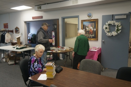 Elfie Nelson is visiting with Lee Schinck at the Golden Oaks Rummage sale while Betty Rogers is looking over some items. Photo Credit/Denise Gilliland, Editor and Chief, Kat Country Hub.