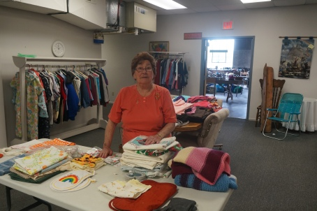 """Margaret Groteluschen assisted with the rummage sale at Golden Oaks, commenting that """"it was a huge success. We had many more items donated for shoppers to purchase this year."""" Photo Credit/Denise Gilliland, Editor and Chief, Kat Country Hub."""