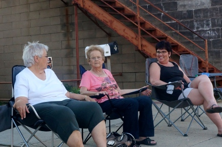 Margaret Buswell, from left, Rojane Linder and Jane Olson are ready to watch the tractor pull at the Swedish Festival. Photo Credit/Denise Gilliland, Editor and Chief, Kat Country Hub.