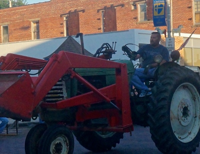 Chad Linder had tractor duties at the Swedish Festival tractor pull. Photo Credit/Denise Gilliland, Editor and Chief, Kat Country Hub.