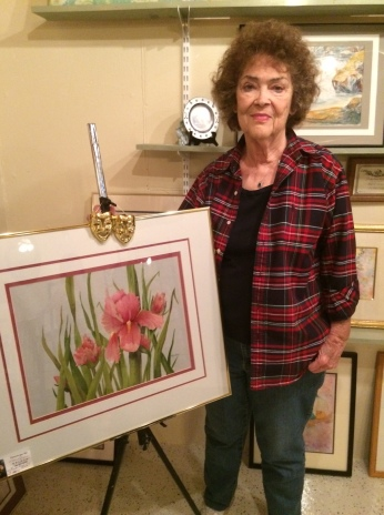 Dona Jean Nelson, pictured with one of her many paintings, is the June Artist of the Month. Photo courtesy of Julie Johnson.