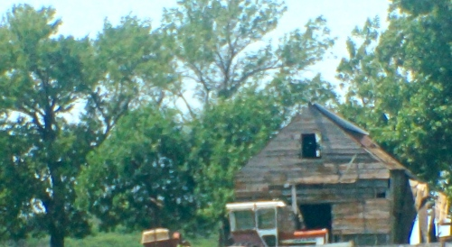 I took this picture in South Dakota while Jeff was driving down the highway at the new speed limit of 80 mph. It is very hard to take a picture while going that fast! I had seen this place before and remembered this time to take a quick picture of it. I love old farm places. Photo Credit/Denise Gilliland/Editor and Chief, Kat Country Hub.