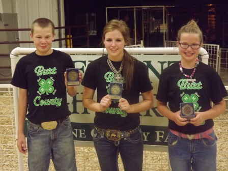 Burt County showmanship skills were apparent at the Fremont 4-H Fair Swine Showmanship Contest Saturday evening in Fremont. Brayden Anderson of Lyons won the Intermediate Division while Jenna Bromm of Oakland won the Senior Division and Elise Anderson of Lyons placed third in the Junior Division. Photo Credit/Kevin Anderson.