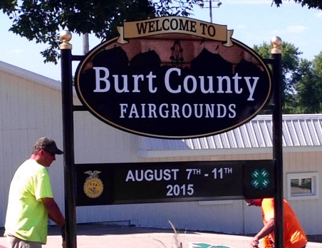 Employees from CBS Signs Inc., where former Oaklander  Don Denton is the General Manager, installed the new Burt County Fair sign this morning. Photo Credit/Denise Gilliland, Editor and Chief, Kat Country Hub.