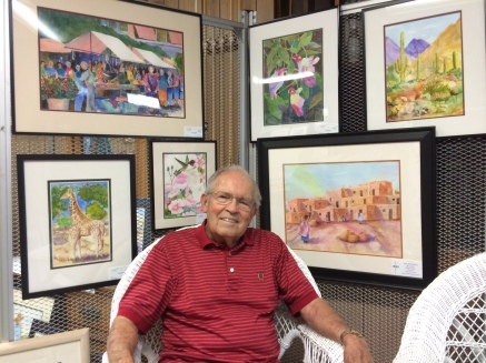 Roger Maller is July Artist of the Month. Roger is surrounded by his artwork in this picture. Photo courtesy of Julie Johnson.