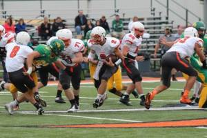 OC quarterback Cole Mitchell tries to find some running room against Bergan. Photo Credit/Cheri Droescher.