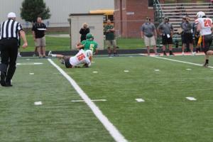 Zach Ahrens is taking down the Bergan QB! Photo Credit/Cheri Droescher.