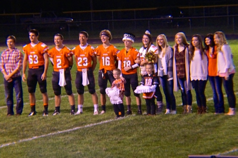 Oakland-Craig Homecoming Royalty, from left: Bryce Uhing (2014 King), Connor Thiele, Cole Mitchell, Cody Mace, Bob Gatewood, King Tommy Nelson, Queen Olivia Bures, Bailey Charling, Brynn Charling, Brie Peterson, Mia Smith, Ashleigh Carr (2014 Queen) and crown bearers Noah Anderson, son of Nathan and Jen Anderson and Keryn Uhing, daughter of Dave and Alisa Uhing. Photo Credit/Denise Gilliland, Editor and Chief, Kat Country Hub.