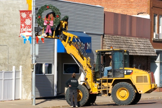 Oakland city employees Bryan Johnson and Mike Francis put up the Christmas decorations last week on Oakland's Main Street. Photo Credit/Denise Gilliland, Editor and Chief, Kat Country Hub.
