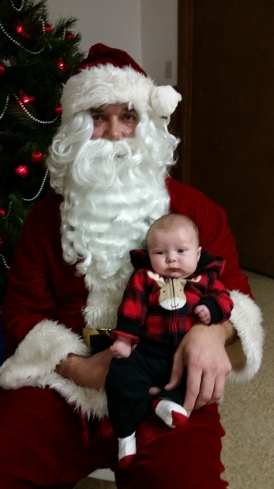 Eli Peterson, son of Brooke and Clint Peterson, is sharing his Christmas  wishes with Santa Claus. Photo Credit/Brooke Peterson.