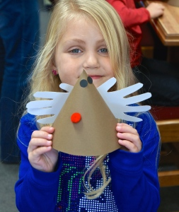 Ava Johnson is proud to show what she made during craft time at the Oakland library. Rudolph! Photo Credit/Denise Gilliland, Editor and Chief, Kat Country Hub.