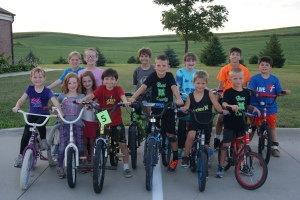 This great looking group of young bikers took to the cement recently to see who could ride the straightest, fastest while maintaining the most control. They also took a safety quiz to check their thinking skills as well as their riding skills. Posing for the photo were: Back row: Madeline Pearson, Alex Davis, Andrew Schlichting, Mariah Bracht, Caleb Schlichting and Eli Schlichting. Front row: Greta Pearson, Coraline Davis, Mady Davis, Connor Davis, Parke Loftis, Carsyn Miller, and Lane Loftis.  Photo Credit/Mary Loftis, Extension Associate.