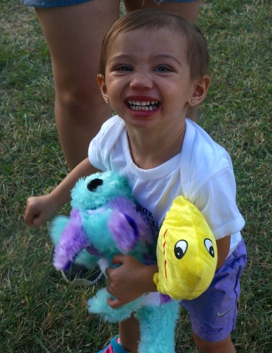 Penelope Tran loves her stuffed animal prizes from the games at the Burt County Fair. Photo Credit/Denise Gilliland, Editor and Chief, Kat Country Hub.