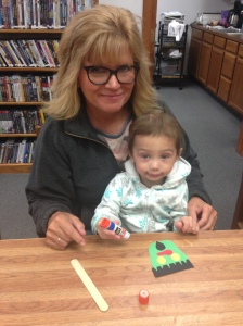 Penelope and I enjoyed story time at the Oakland Public Library. Library Director, Rosa Schmidt, read many books about Halloween. Then the kids made Frankenstein! He slides up in the cup to scare you! Penelope was shy, but afterwards, all smiles with her craft project!